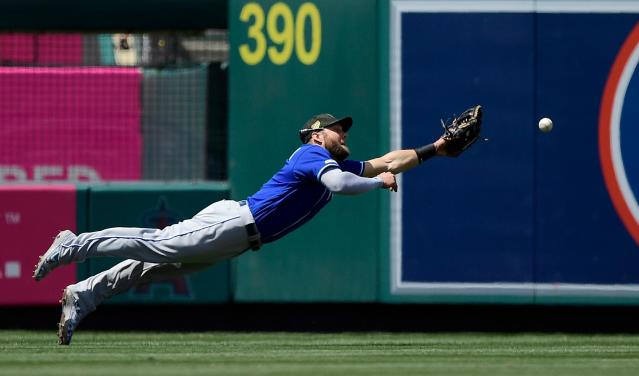 Kansas City Royals left fielder Alex Gordon can't reach a ball hit for an RBI double by Los Angeles Angels' Kevan Smith during the fourth inning of a baseball game Sunday, May 19, 2019, in Anaheim, Calif. (AP Photo/Mark J. Terrill)