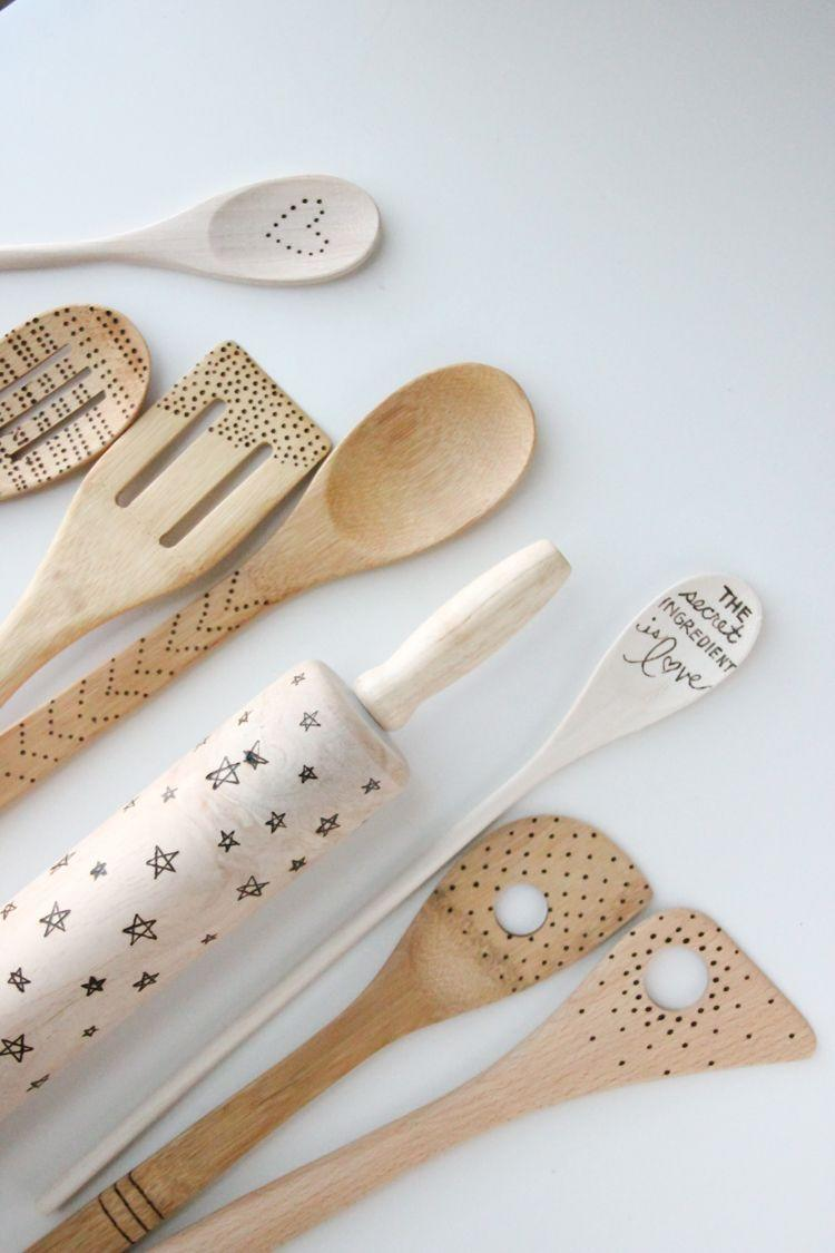 """<p>It only takes one simple tool to create one-of-a-kind wooden spoons, spatulas, and other kitchen accessories. </p><p><a href=""""https://www.deliacreates.com/grandparent-gift-kid-art-etched-wooden-spoons/"""" rel=""""nofollow noopener"""" target=""""_blank"""" data-ylk=""""slk:Get the tutorial."""" class=""""link rapid-noclick-resp"""">Get the tutorial.</a></p><p><a class=""""link rapid-noclick-resp"""" href=""""https://www.amazon.com/Walnut-Hollow-Introduction-Intermediate-Woodburners/dp/B000VRTG8Y?tag=syn-yahoo-20&ascsubtag=%5Bartid%7C10072.g.27603456%5Bsrc%7Cyahoo-us"""" rel=""""nofollow noopener"""" target=""""_blank"""" data-ylk=""""slk:SHOP HOT TOOL"""">SHOP HOT TOOL</a></p>"""