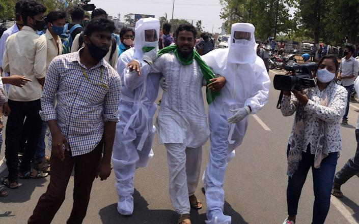 olice personals wear PPE kit as they arresting protesters in front of the state assembly house as they are arrived for protest