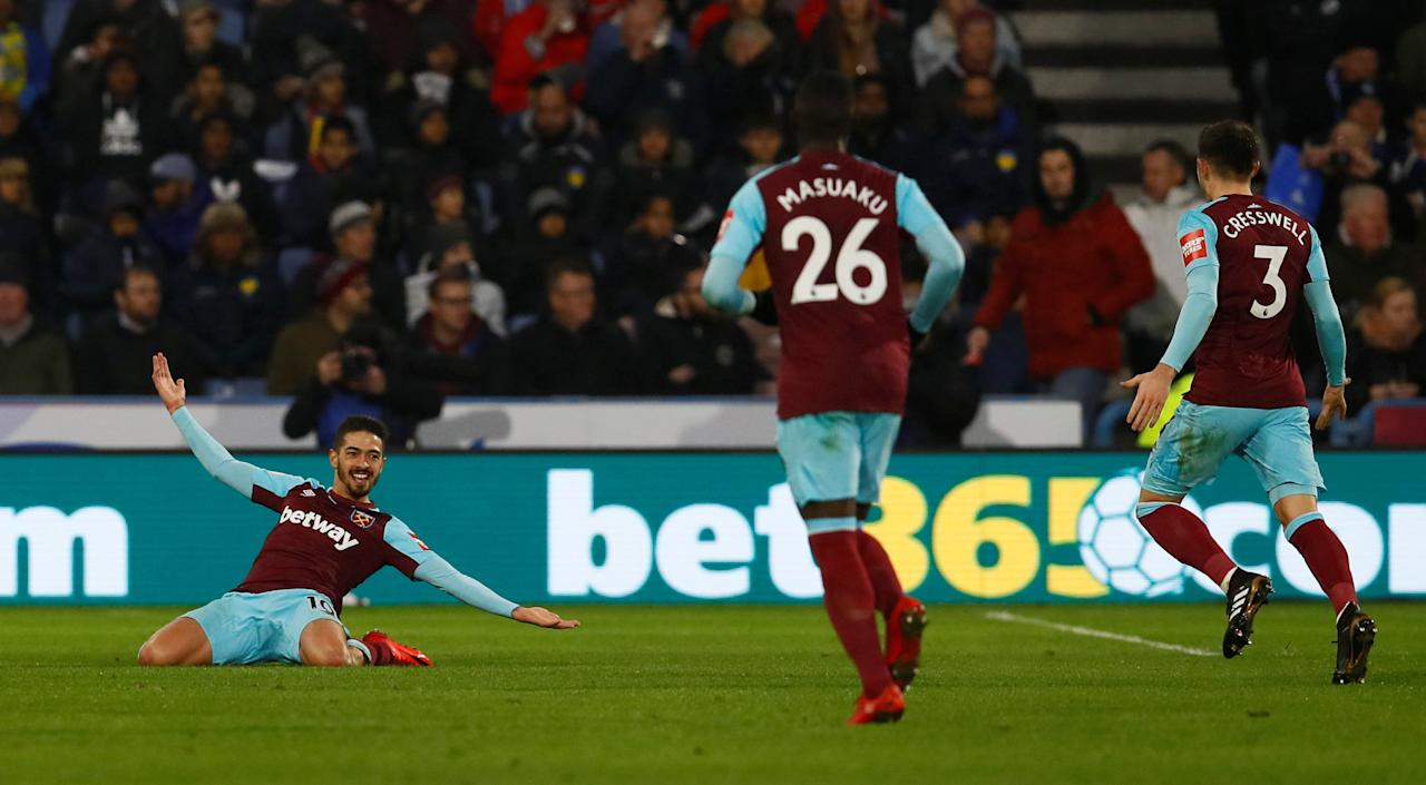 "Soccer Football - Premier League - Huddersfield Town vs West Ham United - John Smith's Stadium, Huddersfield, Britain - January 13, 2018   West Ham United's Manuel Lanzini celebrates scoring their fourth goal    Action Images via Reuters/Jason Cairnduff    EDITORIAL USE ONLY. No use with unauthorized audio, video, data, fixture lists, club/league logos or ""live"" services. Online in-match use limited to 75 images, no video emulation. No use in betting, games or single club/league/player publications.  Please contact your account representative for further details."
