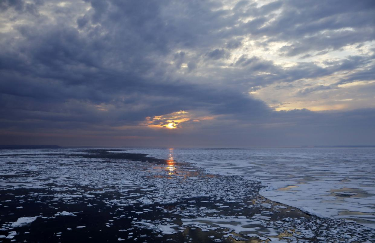 The sun sets over melting sea ice on Peel Sound along the Northwest Passage in the Canadian Arctic Archipelago on July 23. (Photo: David Goldman/AP)