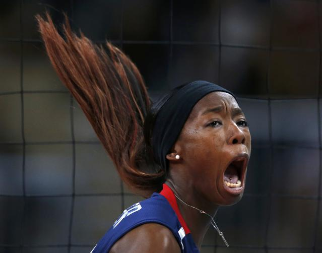 Destinee Hooker of the U.S. celebrates a point against Brazil during their women's gold medal volleyball match at Earls Court during the London 2012 Olympic Games August 11, 2012. REUTERS/Ivan Alvarado (BRITAIN - Tags: OLYMPICS SPORT VOLLEYBALL TPX IMAGES OF THE DAY)