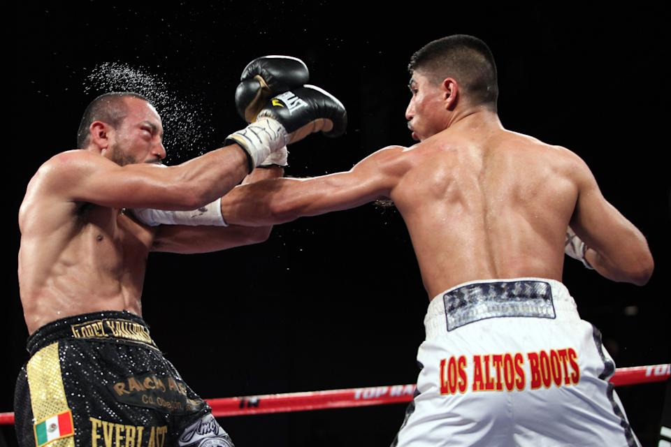 Miguel Angel Garcia, right, in action against WBO Featherweight Champion Orlando Salido  at the Theater at Madison Square Garden on Saturday, January 19, 2013 in New York City. Garcia won the title via Technical Decision in the 8th round after an accidental head butt broke his nose.  Garcia was declared the winner on the scorecards. (AP Photo/Gregory Payan)