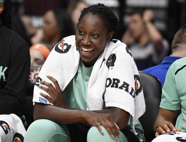 FILE - In this May 14, 2019, file photo, New York Liberty's Tina Charles smiles on the bench during the second half of a preseason WNBA basketball game in Uncasville, Conn. The New York Liberty have traded All-Star Tina Charles to the Washington Mystics as part of a three-team deal, according to a person familiar with the trade. The person spoke to The Associated Press on condition of anonymity because the trade hadnt been announced yet.(AP Photo/Jessica Hill, File)