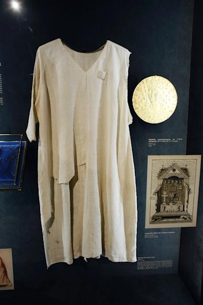 The tunic allegedly worn by the 13th-century French crusader king, Louis IX, was one item rescued during the blaze a the 850-year-old cathedral (AFP Photo/PATRICK KOVARIK)