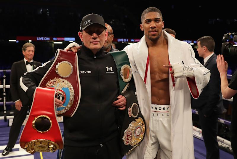 Anthony Joshua with his trainer Rob McCracken. (Credit: Getty Images)