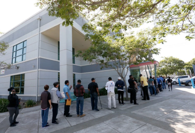 The line at the Claremont Avenue DMV office in Oakland, Calif. (Photo: Jane Tyska/Bay Area News Group)