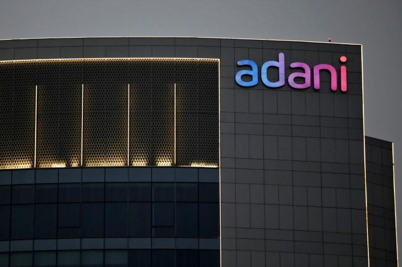 FILE PHOTO: The logo of the Adani Group is seen on the facade of one of its buildings on the outskirts of Ahmedabad