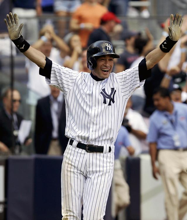 New York Yankees' Ichiro Suzuki reacts after scoring on a wild pitch to win a baseball game during the ninth inning against the Boston Red Sox at Yankee Stadium, Sunday, Sept. 8, 2013, in New York. The Yankees won 4-3. (AP Photo/Seth Wenig)