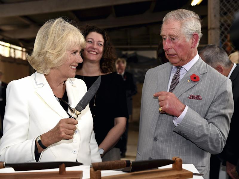 Britain's Prince Charles and his wife Camilla (L), Duchess of Cornwall visit Seppeltsfield Winery in Barossa Valley of South Australia, some 70 kilometres north-east of Adelaide on November 10, 2015. Prince Charles and his wife Camilla are on a two-week tour of New Zealand and Australia. AFP PHOTO / POOL / DANIEL KALISZ (Photo credit should read DANIEL KALISZ/AFP via Getty Images)