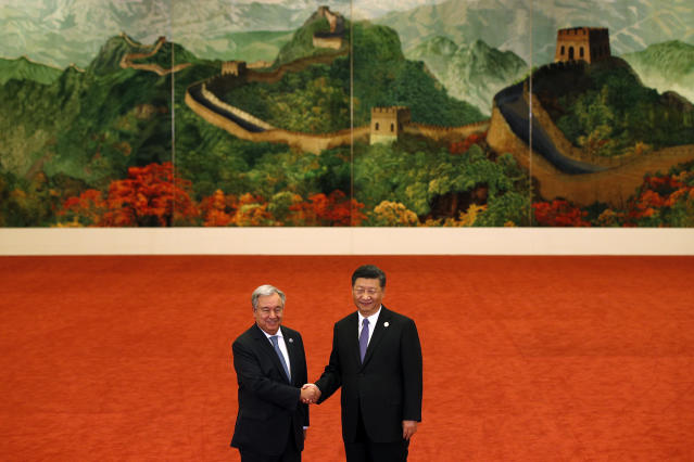 <p>United Nations Secretary-General Antonio Guterres, left, shakes hands with Chinese President Xi Jinping during the Forum on China-Africa Cooperation held at the Great Hall of the People on September 3, 2018 in Beijing, China. (Andy Wong – Pool/Getty Images) </p>