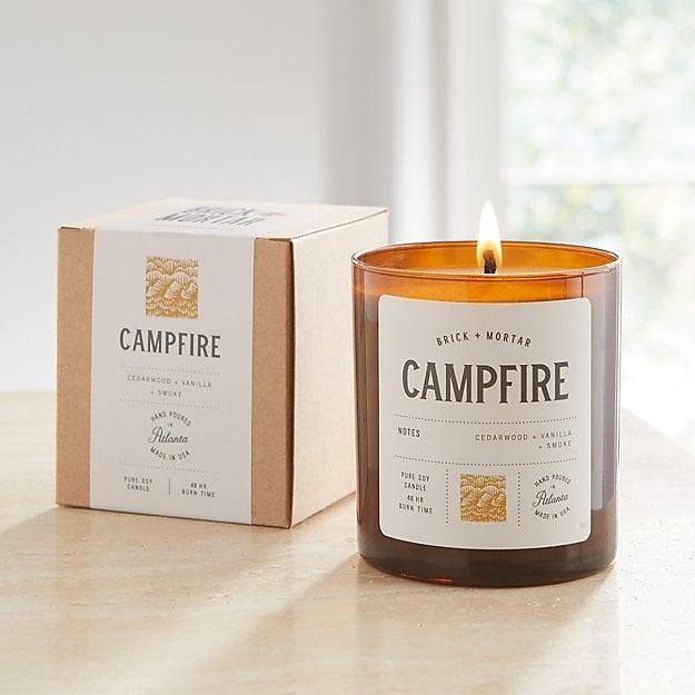 """<a href=""""https://www.crateandbarrel.com/brick-and-mortar-campfire-scented-candle/s336924"""" rel=""""nofollow noopener"""" target=""""_blank"""" data-ylk=""""slk:Brick & Mortar Campfire Candle"""" class=""""link rapid-noclick-resp""""><h3>Brick & Mortar Campfire Candle</h3></a><br>Wondering how to recall, """"the welcoming aroma of a campfire with scents of cedarwood and vanilla accented with soft smoke,"""" into your fireplace-less space? Just light up this candle. <br><br><strong>Brick & Mortar</strong> Campfire Candle, $, available at <a href=""""https://go.skimresources.com/?id=30283X879131&url=https%3A%2F%2Fwww.crateandbarrel.com%2Fbrick-and-mortar-campfire-scented-candle%2Fs336924"""" rel=""""nofollow noopener"""" target=""""_blank"""" data-ylk=""""slk:Crate and Barrel"""" class=""""link rapid-noclick-resp"""">Crate and Barrel</a>"""