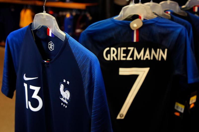 The new jerseys of French national soccer team, bearing two stars, hang in the French Soccer Federation (FFF) headquarters in Paris, Friday, Aug. 17, 2018. The long awaited two-star jersey 2018 went on sale today in France. France won the 1998 and 2018 soccer World Cup. (AP Photo/Michel Euler)