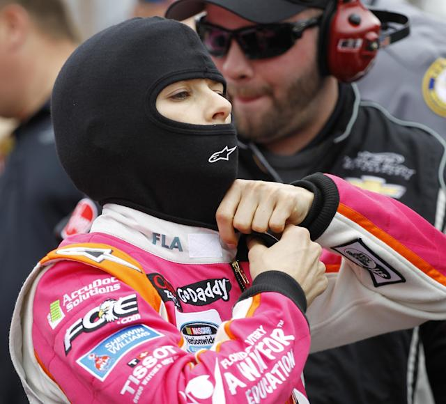 Danica Patrick prepares for the NASCAR Nationwide series auto race at Daytona International Speedway in Daytona Beach, Fla., Saturday, Feb. 22, 2014. (AP Photo/Terry Renna)