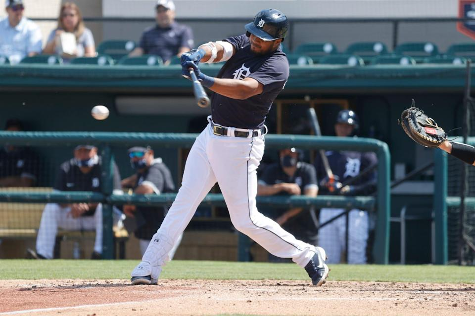 Tigers third baseman Jeimer Candelario singles against the Yankees during the third inning at Publix Field at Joker Marchant Stadium on Friday, March 12, 2021.