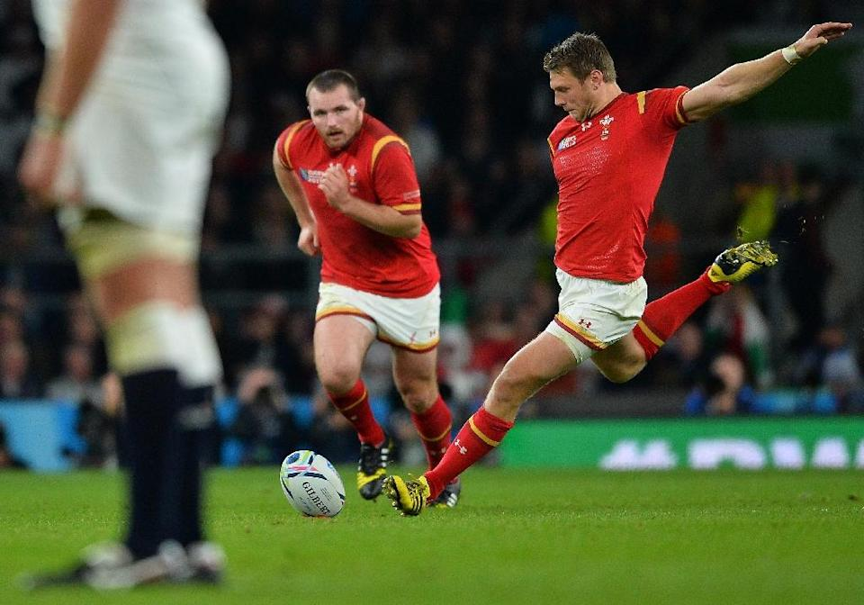 Wales fly half Dan Biggar (R), who normally sees the kicking duties handled by the injured Leigh Halfpenny, emerged from the shadows to kick 23 points from seven penalties and a conversion, a record points haul for a Welshman against England (AFP Photo/Glyn Kirk)
