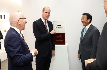 Britain's Prince William talks with Michael Houlihan, Director General of Japan House, and Taro Aso, Japan's Deputy Prime Minister, after unveiling a plaque at the official opening of Japan House in London, Britain, September 13, 2018. Tim P. Whitby/Pool via REUTERS