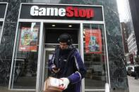 A Fedex deliveryman prepares a package for a GameStop store in New York