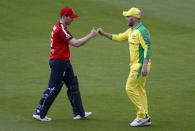 England's captain Eoin Morgan, left, fist bumps with Australia's captain Aaron Finch after their win in the second Twenty20 cricket match between England and Australia, at the Ageas Bowl in Southampton, England, Sunday, Sept. 6, 2020. (Paul Childs/Pool via AP)
