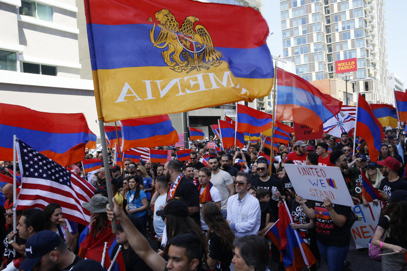 Huge crowds of Armenian Americans march in Los Angeles during an annual commemoration of the deaths of 1.5 million Armenians under the Ottoman Empire Wednesday, April 24, 2019. The march was intended to press demands that Turkey, the successor of the Ottoman Empire, recognize the deaths as genocide. Turkey contends the deaths starting in 1915 were due to civil war and unrest. (AP Photo/Damian Dovarganes)