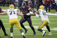 Houston Texans defensive end J.J. Watt (99) tries to get past Green Bay Packers offensive tackle Rick Wagner (71) and tight end Marcedes Lewis (89) during the first half of an NFL football game Sunday, Oct. 25, 2020, in Houston. (AP Photo/Eric Christian Smith)