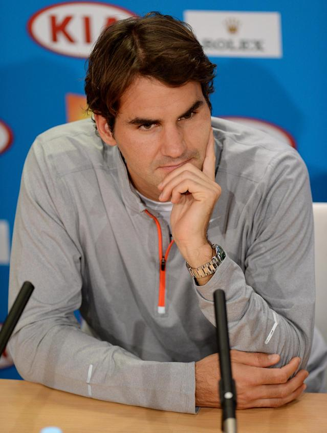 Switzerland's Roger Federer answers questions at a press conference following his loss to Britain's Andy Murray in their semifinal at the Australian Open tennis championship in Melbourne, Australia, Saturday, Jan. 26, 2013. (AP Photo/Andrew Brownbill)