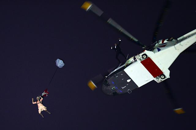 An actor dressed as the Queen parachutes into the Opening Ceremony of the 2012 Olympic Games in London. (Getty)