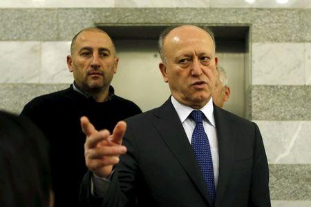 Lebanon's Justice Minister Ashraf Rifi gestures upon his arrival to attend a Cabinet session at the government palace in Beirut, January 22, 2015. REUTERS/Mohamed Azakir
