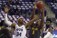 TCU forward Kevin Easley (34) and Baylor guard Mark Vital (11) try to grab a rebound in the second half of an NCAA college basketball game, Saturday, Jan. 9, 2021, in Fort Worth, Texas. (AP Photo/ Richard W. Rodriguez)