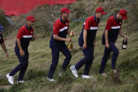Team USA players head to the clubhouse after the Ryder Cup matches at the Whistling Straits Golf Course Sunday, Sept. 26, 2021, in Sheboygan, Wis. (AP Photo/Charlie Neibergall)