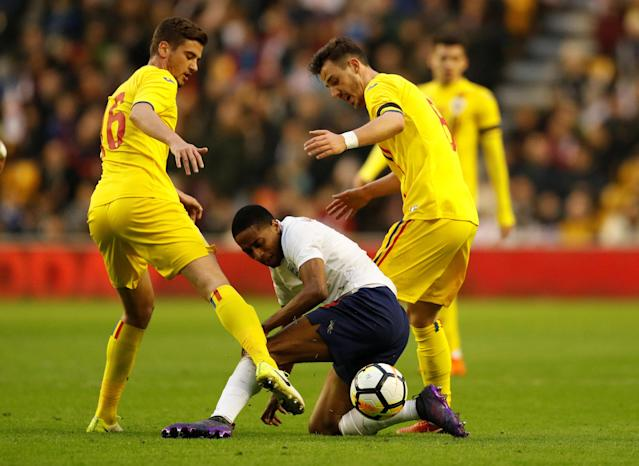 Soccer Football - Under 21 International Friendly - England vs Romania - Molineux Stadium, Wolverhampton, Britain - March 24, 2018 England's Kyle Walker-Peters in action with Romania's Dragos Nedelcu and Razvan Oaida Action Images via Reuters/Andrew Boyers