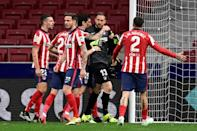 Atletico Madrid players congratulate goalkeeper Jan Oblak after his crucial late penalty save against Alaves