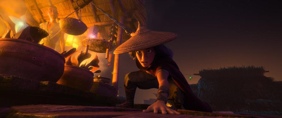 """Animated character Raya, voiced by Kelly Marie Tran, appears in a scene from """"Raya and the Last Dragon."""" (Disney+ via AP)"""