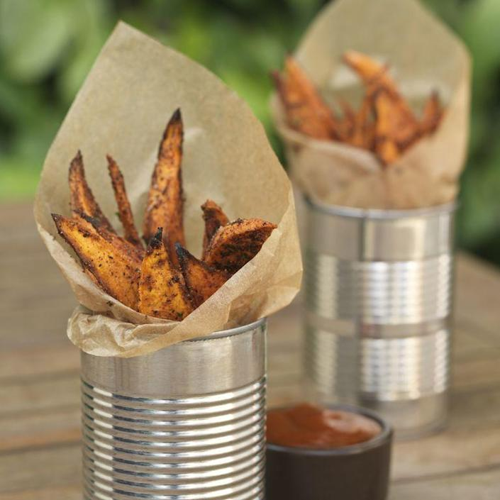 """<p>Your super fans won't be able to stop eating these crispy spiced sweet potato fries while watching the game.</p><p><span class=""""redactor-invisible-space""""><em>Get the recipe at <a href=""""http://www.countryliving.com/food-drinks/recipes/a1367/oven-baked-sweet-potato-fries-3483/"""" rel=""""nofollow noopener"""" target=""""_blank"""" data-ylk=""""slk:Country Living"""" class=""""link rapid-noclick-resp"""">Country Living</a>.</em><br></span></p>"""