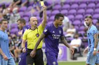 Orlando City defender Antonio Carlos is given a yellow card as he walks away during the second half of an MLS soccer playoff match against the New York City FC, Saturday, Nov. 21, 2020, in Orlando, Fla. (AP Photo/Phelan M. Ebenhack)