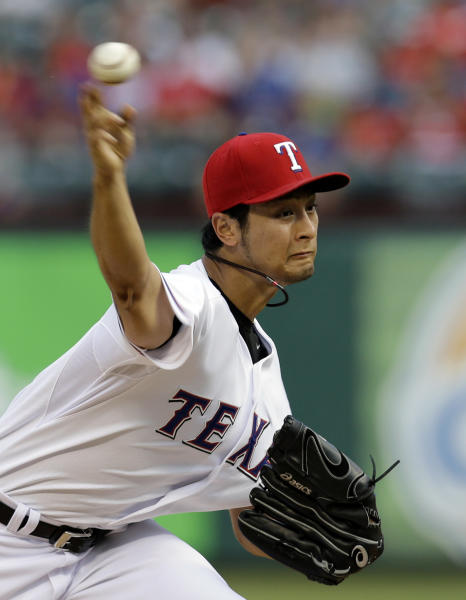 Texas Rangers starting pitcher Yu Darvish (11) of Japan delivers to the Oakland Athletics in the first inning of a baseball game Tuesday, June 18, 2013, in Arlington, Texas. (AP Photo/Tony Gutierrez)