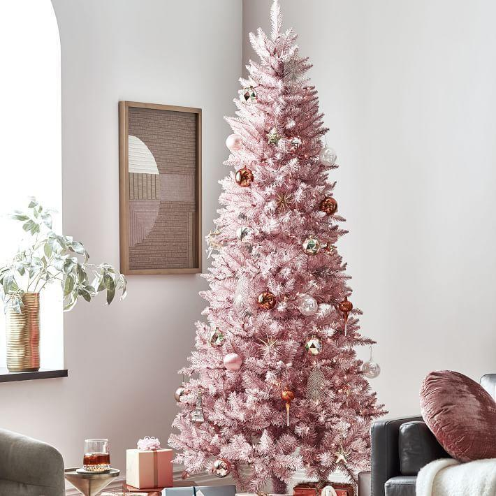 """<p>westelm.com</p><p><strong>$350.00</strong></p><p><a href=""""https://go.redirectingat.com?id=74968X1596630&url=https%3A%2F%2Fwww.westelm.com%2Fproducts%2Fpink-tinsel-trees-d6641&sref=https%3A%2F%2Fwww.housebeautiful.com%2Fentertaining%2Fholidays-celebrations%2Fg4010%2Fbest-artificial-christmas-trees%2F"""" rel=""""nofollow noopener"""" target=""""_blank"""" data-ylk=""""slk:BUY NOW"""" class=""""link rapid-noclick-resp"""">BUY NOW</a></p><p>Take a trip back to the '60s with an unapologetically pink tree. How can you <em>not</em> smile with this item in the room?</p>"""