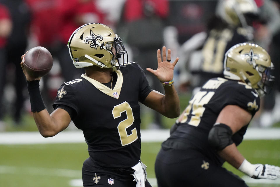 New Orleans Saints quarterback Jameis Winston (2) works in the pocket against the Tampa Bay Buccaneers during the first half of an NFL divisional round playoff football game, Sunday, Jan. 17, 2021, in New Orleans. (AP Photo/Brynn Anderson)