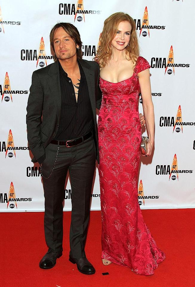 """Keith Urban and Nicole Kidman  Grade: A-  The Aussie hunk sported a typically casual look (and a chest tattoo), while his wax-figurine-like wife rocked a beaded red beauty. Taylor Hill/<a href=""""http://www.wireimage.com"""" target=""""new"""">WireImage.com</a> - November 11, 2009"""