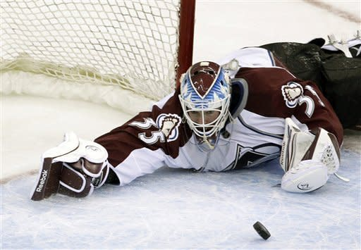 Colorado Avalanche goalie Jean-Sebastien Giguere (35) makes a save against the New Jersey Devils during the second period of an NHL hockey game in Newark, N.J., Thursday, March 15, 2012. (AP Photo/Mel Evans)
