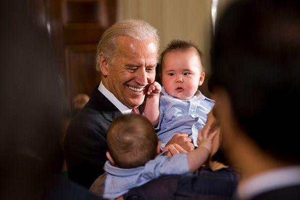<p>Biden greets visitors in the East Room of the White House in May 2009. </p>