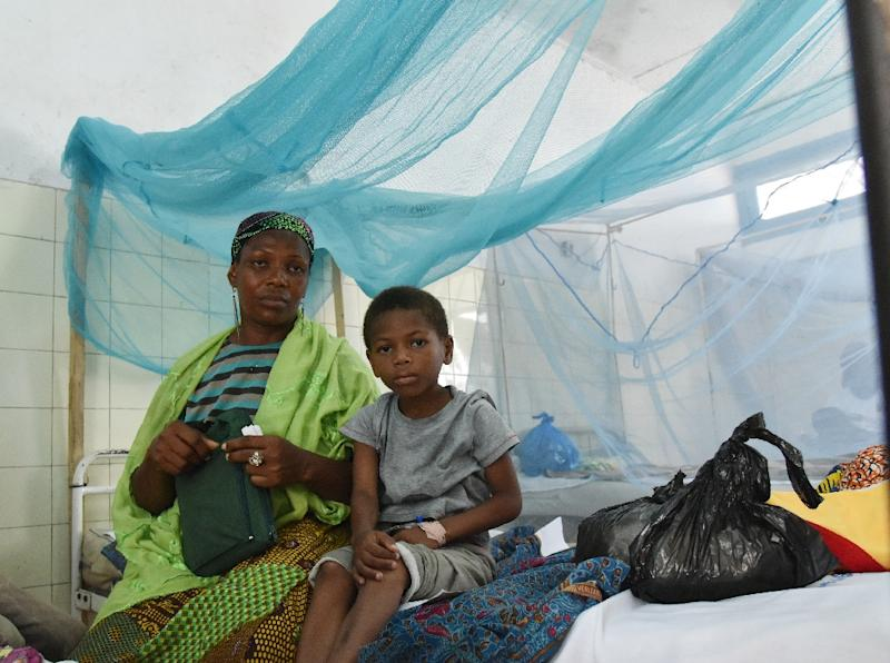 With mosquitoes largely circulating at night, a mass distribution of nets in high malaria areas has helped significantly bring down infections, especially among children, a report says (AFP Photo/Sia Kambou)
