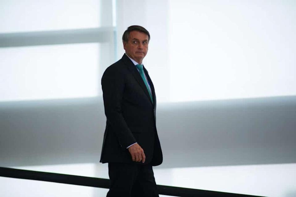 President of Brazil Jair Bolsonaro arrives for a ceremony on National Day For The Struggle Of People With Disabilities. (Andressa Anholete/Getty Images)