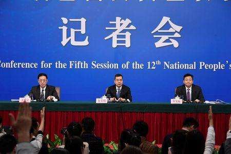 NPC officials hold a news conference on the sidelines of the National People's Congress in Beijing