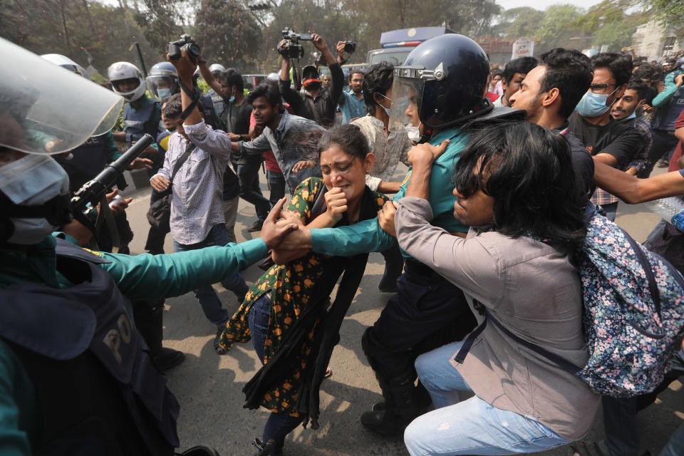 Bangladeshi students clash with police during a protest in Dhaka, Bangladesh, Monday, March 1, 2021. About 300 student activists rallied in Bangladesh's capital on Monday to denounce the death in prison of Mushtaq Ahmed, a writer and commentator who was arrested last year on charges of violating a sweeping digital security law that critics say chokes freedom of expression. (AP Photo/Mahmud Hossain Opu)