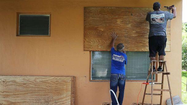 PHOTO: People put up shutters as they prepare a family member's house for Hurricane Irma, Sept. 6, 2017, in Miami. (Joe Raedle/Getty Images)
