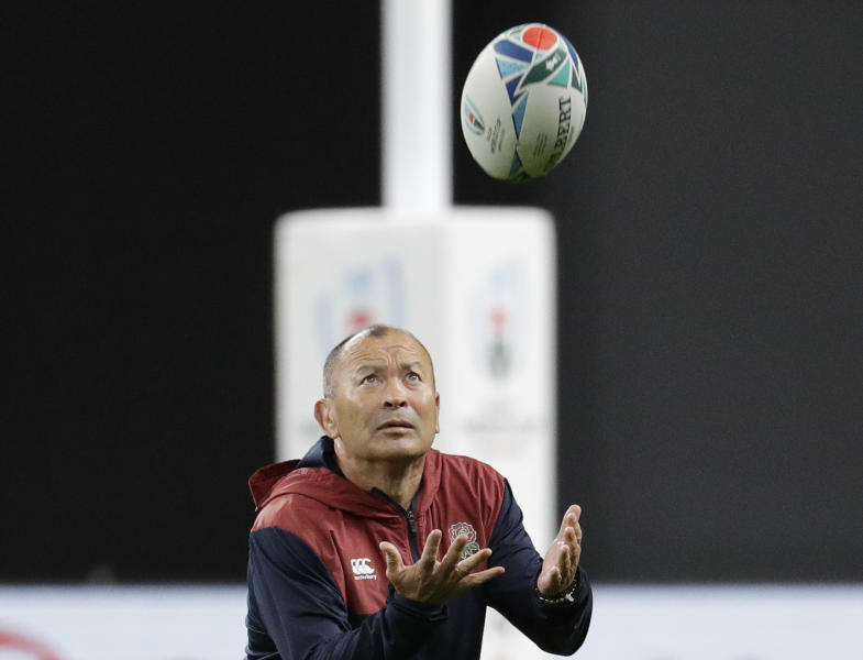 England rugby coach Eddie Jones catches the ball during a training session before the start of Rugby World Cup in Sapporo, northern Japan Friday, Sept. 20, 2019. England will play Tonga on Sunday Sept. 22 in their first game. (AP Photo/Aaron Favila)