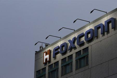 The logo of Foxconn, the trading name of Hon Hai Precision Industry, is seen on top of the company's headquarters in New Taipei City, Taiwan