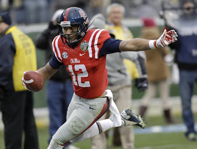 Mississippi wide receiver Donte Moncrief runs the ball into the end zone as he scores a touchdown on a 28-yard pass play against Georgia Tech in the second quarter of the NCAA college football Music City Bowl game on Monday, Dec. 30, 2013, in Nashville, Tenn. (AP Photo/Mark Humphrey)