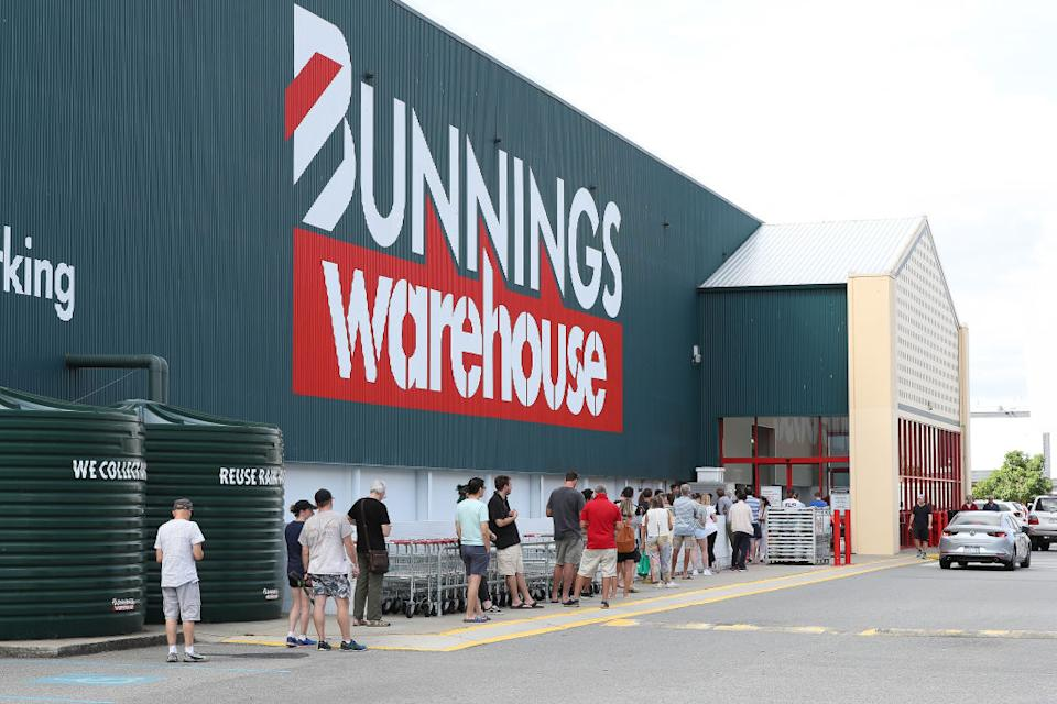 Shoppers are forced to queue outside Bunnings in Myaree due to new government social distancing measures in Perth, Australia.